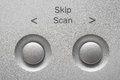 Macro of Skip, Scan buttons on aluminum panel. Royalty Free Stock Photo