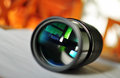 Macro of a slr camera zoom lens reflecting window  Royalty Free Stock Photography