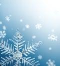 Macro Snowflake and Fallen Defocused Snowflakes Royalty Free Stock Photo