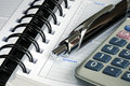 Macro view of the calculator, pen, and the diary Royalty Free Stock Photo