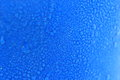 Macro water drops background on blue cup. Royalty Free Stock Photo