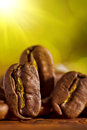 Macroshot of coffee beans on the blurry background Stock Photo