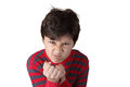 Mad angry boy with clenched fists on white isolated background Royalty Free Stock Photos