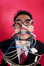 Mad businessman with cables Stock Photography