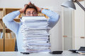 The mad businessman with piles of papers Royalty Free Stock Photo