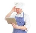 Mad chef cook with tablet pc Royalty Free Stock Photography