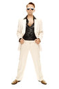 Mad disco dancer in white suit and snake leather boots with selfconfident appearance on background Royalty Free Stock Photos