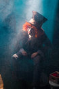 Mad hatter sitting in a chair Royalty Free Stock Photo
