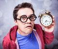 Mad man with clock studio shot Stock Photography