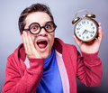 Mad man with clock studio shot isolated Stock Images