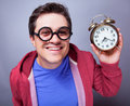 Mad man with clock studio shot isolated Stock Photo