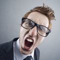 Mad man portrait of nerd businessman shouting at camera Royalty Free Stock Photos