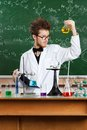 Mad professor examines Bunsen flask Royalty Free Stock Photography