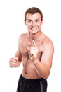 Mad shirtless man showing fist and pointing at you isolated on white background Royalty Free Stock Photos