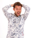 Mad shout isolated shot of a young man in a flowery shirt shouting Royalty Free Stock Image