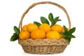 Madarin orange fruits in a wicker basket isolated on white background Stock Photo
