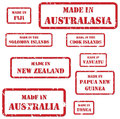 Made in australasia stamps set of red rubber of symbols for region Stock Photos