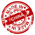 Made in china poster or stamp with the words with red on white scratched or grunge style Royalty Free Stock Images