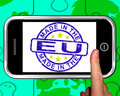 Made in the eu on smartphone shows european products or production Royalty Free Stock Photos