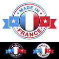 Made in france badge label and icon with ribbon and central glossy french flag symbol vector eps illustration with three different Royalty Free Stock Photography