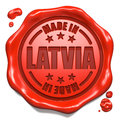 Made in latvia stamp on red wax seal isolated white business concept d render Royalty Free Stock Photo