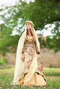 Madieval lady at outdoor near green tree Royalty Free Stock Photography