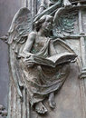 Madrid detail of angel from modern bronze gate of almudena cathedral by artist consuelo perea in march in spain Stock Photos