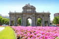 Madrid Puerta de Alcala with flower gardens Royalty Free Stock Photography