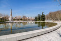 Madrid río fountain obelisk and perrault bridge partial view of the park where we can see the source of pipes the obelico the Royalty Free Stock Photography