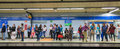 Madrid tube underground station with commuters awaiting train spain may Royalty Free Stock Image