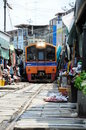 Maeklong railway thailand the became famous for its route through the market nicknamed thai talad rom hoop meaning the umbrella Stock Photos