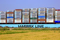 Maersk line container ship passing suez canal in egypt beside land Royalty Free Stock Images