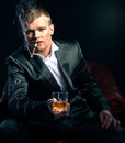 Mafia boss in the red chair dramatic lighting Royalty Free Stock Images