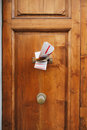 Magazines in a letterbox of a door multiple wooden focus is on the newspaper and Royalty Free Stock Images