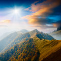 Magestic landscape carpathian mountain valley with colorful clouds in a sunset light Stock Photos