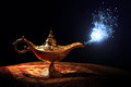 Magic aladdins genie lamp from the story of aladdin with appearing in blue smoke concept for wishing luck and Royalty Free Stock Photography