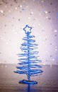 A magic blue metallic modern christmas tree on wood table light bokeh background Stock Photos