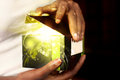 Magic gift box african american woman opening a Stock Image