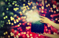 Magic gift box with lights in their hands Royalty Free Stock Photo