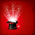 Magic hat vintage background with magician wand and magical glow Royalty Free Stock Image