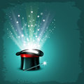 Magic hat vintage background with magician wand and magical glow Stock Photos