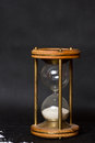 Magic hourglass with blue shiny flares and ashes Stock Image