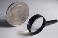 Magic jumbo dollar and magnifying glass isolated half coin Stock Image