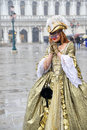 Magic of a mask and snow pretty girl dressed up for the carnival in venice with an elegant dress while the was falling down Royalty Free Stock Image