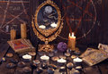 Magic ritual with ancient runes, mirror, tarot cards and candles. Royalty Free Stock Photo
