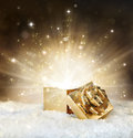 Magic shining of christmas gift golden stardust and snow Royalty Free Stock Image
