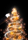 Magic wand and glittering Christmas tree Royalty Free Stock Photo
