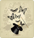 Magic wand and hat with butterflies on a vintage b Royalty Free Stock Photo