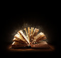 Magical book or bible the magic of reading storytelling and education and religion black background space above for text message Stock Image