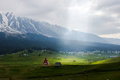 Magical valley mountain village landscape a in a surrounded by beautiful snow covered peaks and a beam of light through the rainy Royalty Free Stock Photos